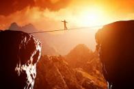 man walking across rocks risk free rate