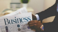 business man reading top investment papers Feb 2017