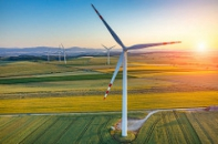 Savvy Awards 2017 Best ESG Paper wind turbine sunset